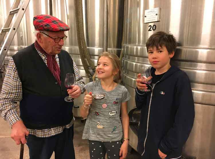 François Gaunoux and his grandchildren in the winery